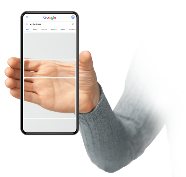 a hand holding a phone with an invisible screen