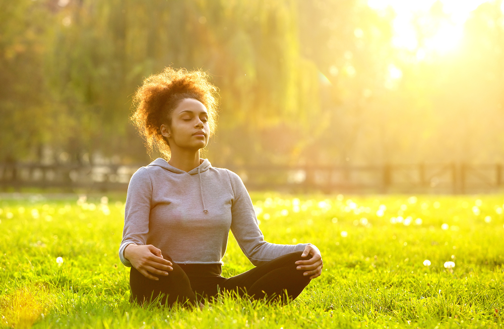 woman enjoying sounds of nature for mental health