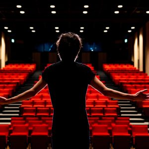 actor in a theatre addressing an empty audience